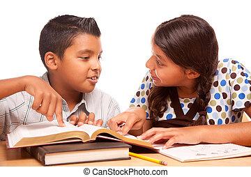 Hispanic Brother and Sister Having Fun Studying