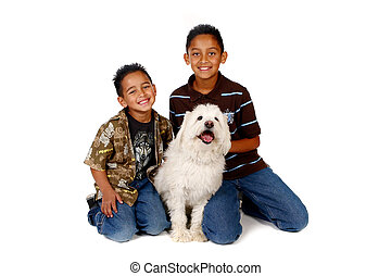 Hispanic Brothers With Their Dog on White