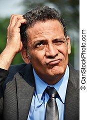 Hispanic Business Executive And Confusion