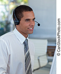Hispanic businessman working in a call center