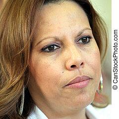 Hispanic businesswoman. - Hispanic businesswoman attending a...
