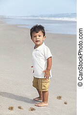 Hispanic Child Boy Happy Playing at a Sunny Beach