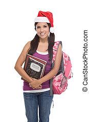 Hispanic college student girl in Christmas hat