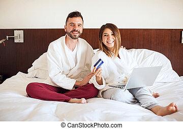 Hispanic couple doing some online shopping