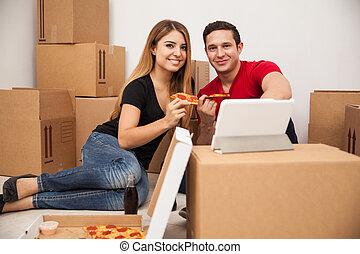 Hispanic couple moving