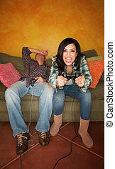 Hispanic Couple Playing Video game