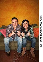 Hispanic Couple Playing Video game