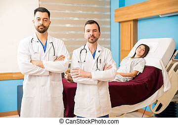 Hispanic doctors in a hospital room