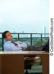 Hispanic Executive Reclining Thinking Looking Up