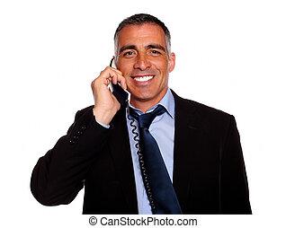 Hispanic executive smiling with a phone