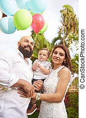 Hispanic family in park