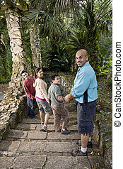 Hispanic family walking down stairs outdoors