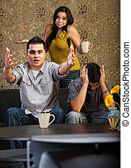 Hispanic Family Watching TV
