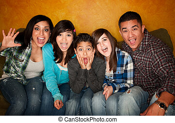 Hispanic Familywith Big Reaction