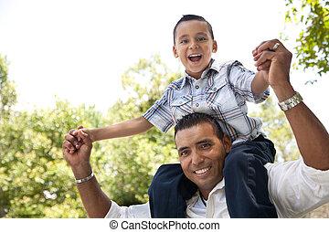 Hispanic Father and Son Having Fun in the Park - Hispanic ...