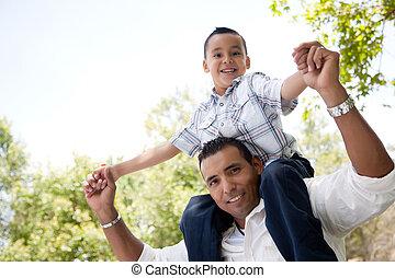 Hispanic Father and Son Having Fun in the Park - Hispanic...