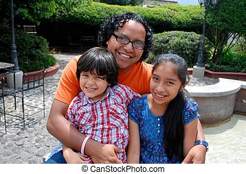 Hispanic father with two kids