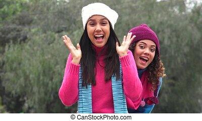 Hispanic Friends Having Fun Happy Photobomb