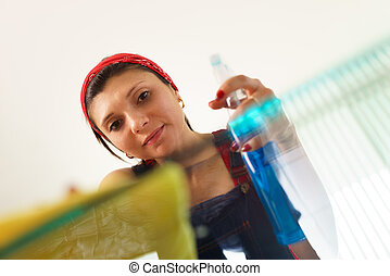 Hispanic Girl Maid At Home Doing Chores Cleaning Glass Table