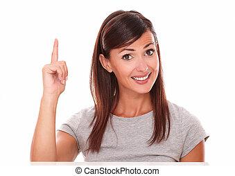 Hispanic girl pointing up while smiling