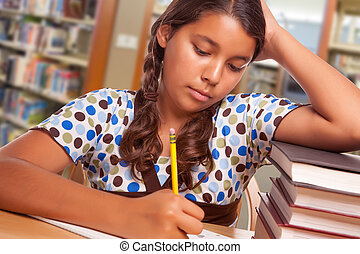 Hispanic Girl Student with Pencil and Books Studying in Library