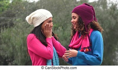 Hispanic Girls  Friends Talking Wearing Sweaters