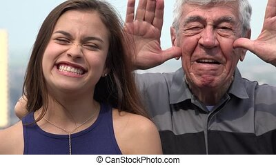Hispanic Grandfather And Granddaughter Funny Faces