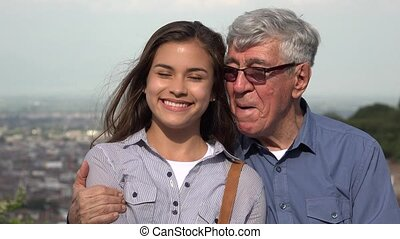 Hispanic Grandfather And Granddaughter Loving Family