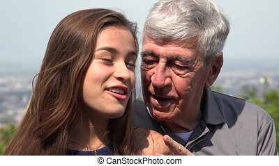 Hispanic Grandfather Talking To Granddaughter