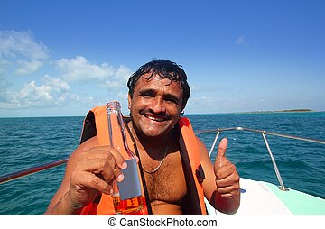 hispanic latin man vacation enjoying boat beer summer
