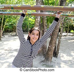 hispanic latin teenager girl playing in park playground