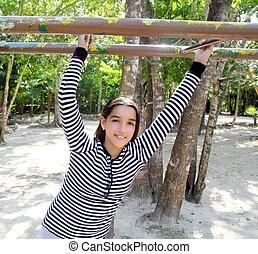 hispanic latin teenager girl playing in park playground