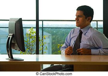 Hispanic Male Executive Office Looking Monitor - A...
