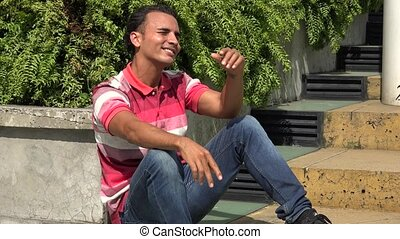 Hispanic Male Sitting And Thinking