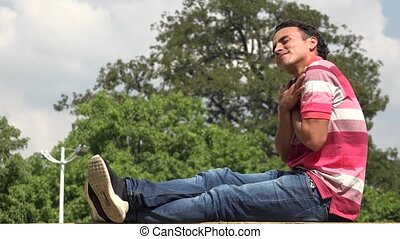 Hispanic Male Sitting In Love