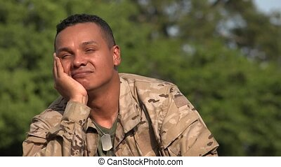 Hispanic Male Soldier Daydreaming Wearing Camo