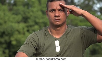 Hispanic Male Soldier Saluting
