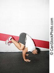 hispanic man acrobatics gymnastic doing a exercise gym, athletic sportsman