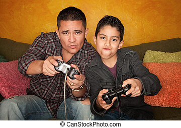 Hispanic Man and Boy Playing Video game