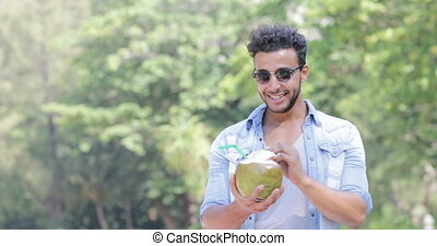 Hispanic Man Drink Coconut Cocktail Over Palm Trees, Happy...