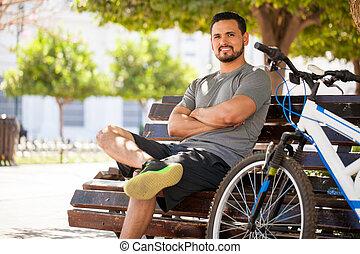 Hispanic man exercising on his bicycle