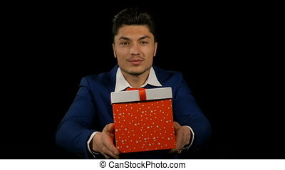 Hispanic man hands out his Christmas gift box