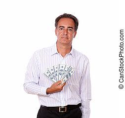 Hispanic man holding money while standing