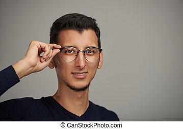 Hispanic man in glasses