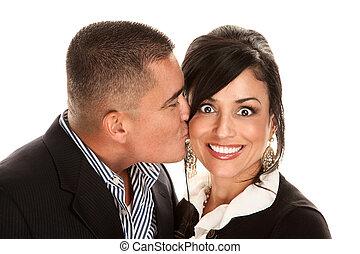 Hispanic man kissing pretty woman
