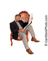 Hispanic man reading the newspaper.