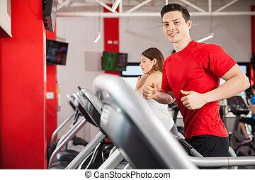 Hispanic man running at the gym
