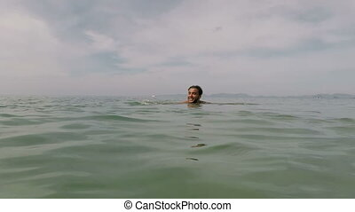 Hispanic Man Swimming In Sea Water Action Camera POV Of...