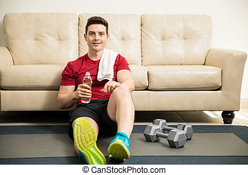 Hispanic man taking a break from his workout - Attractive...
