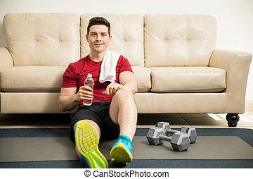 Hispanic man taking a break from his workout